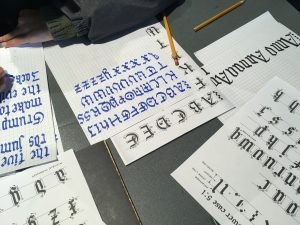 Children's practice of Gothic calligraphy