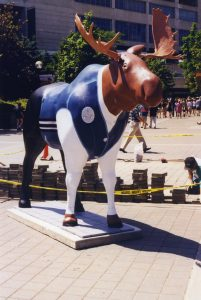 A sculpture of a moose painted in the uniform of a CN Tower employee. Painted by Michele Nidenoff. Toronto, Ontario.